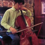 Cellist Cheung Chau at Hershey Violins for adjustments to his instrument before departing for Beijing, China where he will perform in concert and conduct master classes.