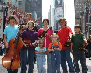The King's Strings posing in New York's Times Square.  From left to   right: Jesse (13), John, Mariana (11), HopeAnne (3), Cindy, Eden (5), Andrew   (15), and Isaac (9)