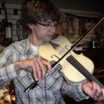 Apprentice Ryan playing his first violin in the white.